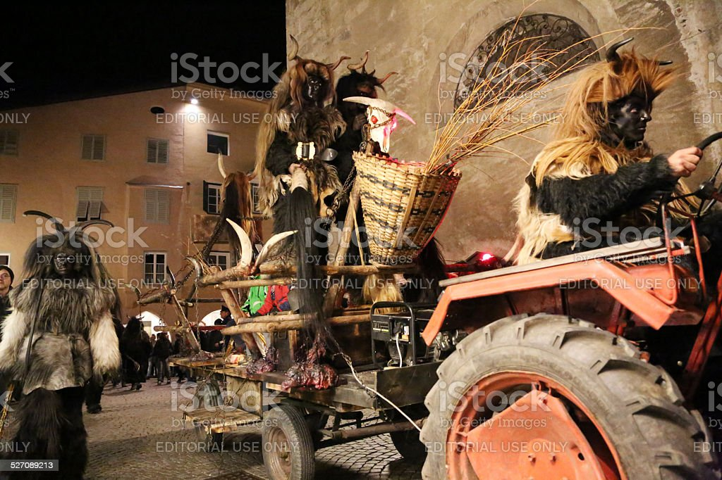 Various Krampus on tractor stock photo