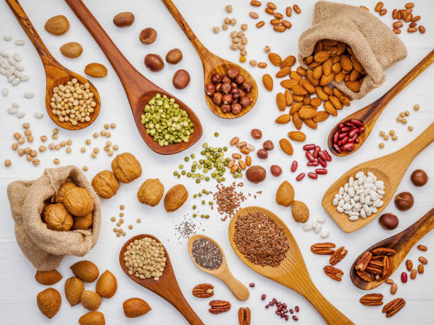 Various legumes and different kinds of nuts in spoons walnuts kernels picture id670671832?b=1&k=6&m=670671832&s=612x612&w=0&h=wrzg2ryctosurrr1eotarrb4jnlrc96a7jz9t152nfk=