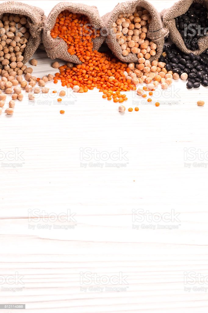 various legumes on wooden background,healthy food,vegan food. stock photo