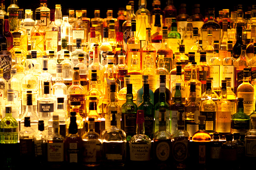 Various Liquor bottles backlit.