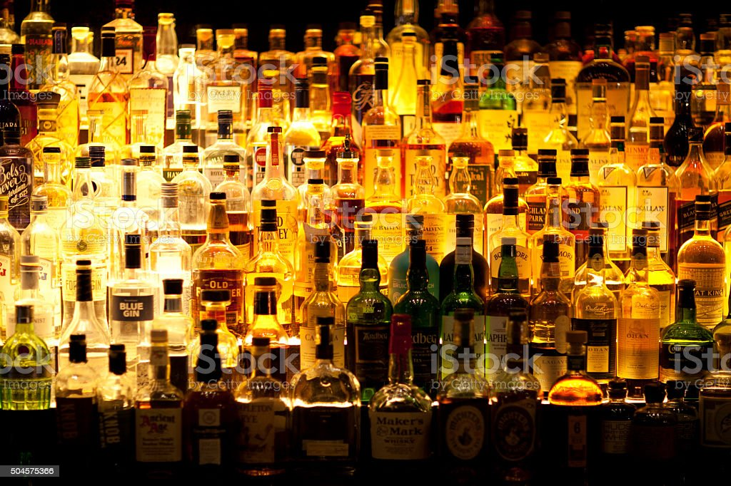 Various Liquor bottles backlit. stock photo