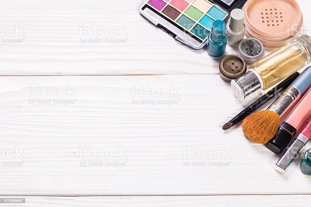 Various makeup products on wooden background with copyspace stock photo