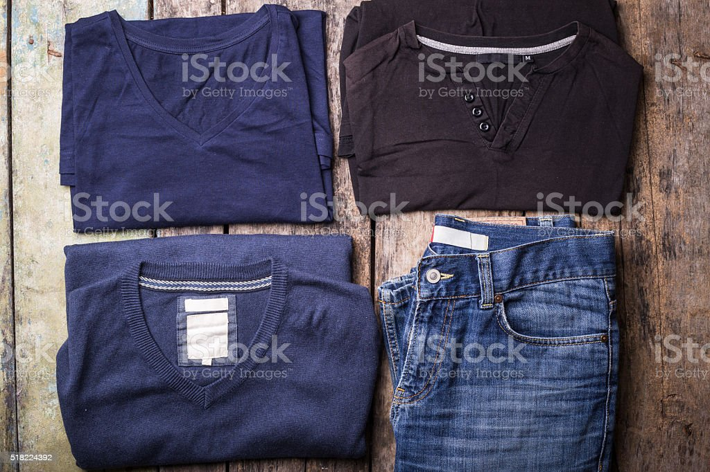 Various Man clothes collected on wooden background stock photo