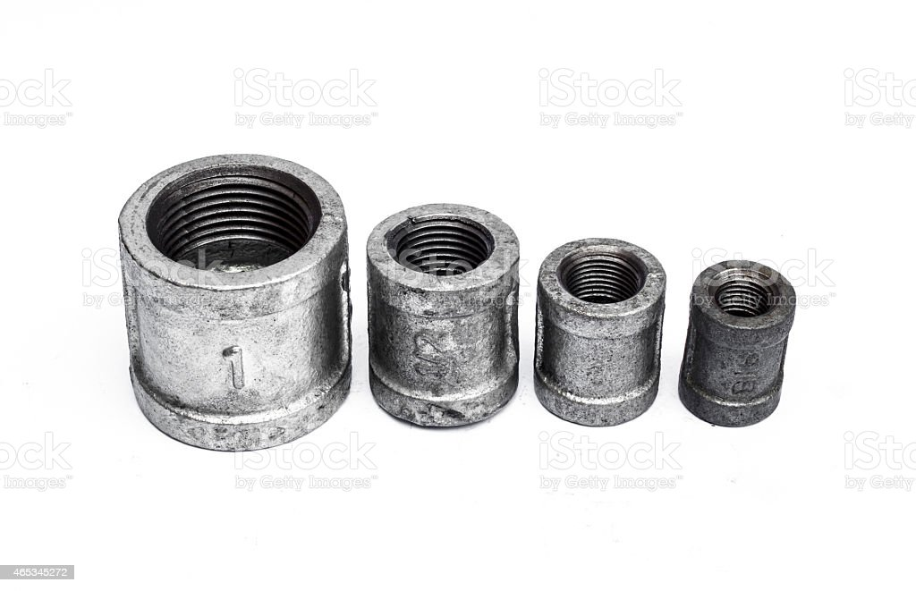 various metal fittings inner, for pipes on white stock photo
