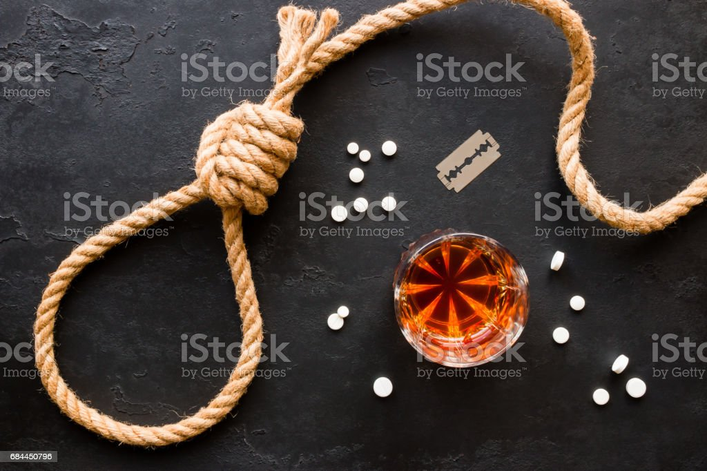 various methods of suicide - rope slipknot, blades, pills and alcohol stock photo