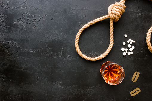 various methods of suicide - rope slipknot, blades, pills and alcohol with space for text