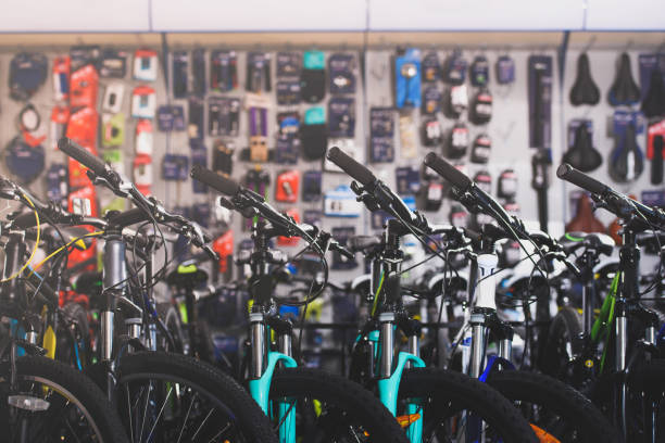 various modern bikes selling in bicycle shop various modern bikes selling in bicycle shop bicycle shop stock pictures, royalty-free photos & images