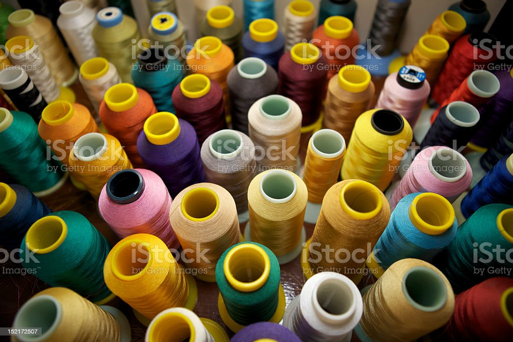 Various multicolored spools of thread royalty-free stock photo