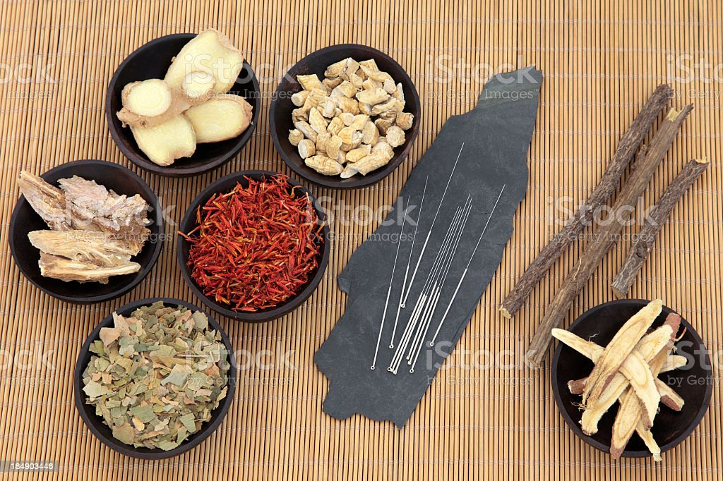 Various natural remedies with acupuncture pins on bamboo stock photo