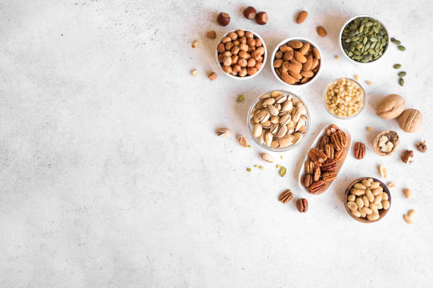 Various Nuts in  bowls stock photo