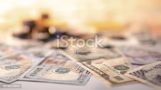 Various of international money coin and banknote background. Time investment with currency exchange concept. Focus on dollar banknote.