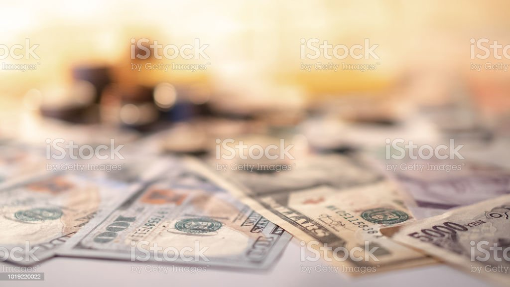 Various of international money coin and banknote background. Time investment with currency exchange concept. Focus on dollar banknote. stock photo