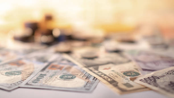 Various of international money coin and banknote background. Time investment with currency exchange concept. Focus on dollar banknote. Various of international money coin and banknote background. Time investment with currency exchange concept. Focus on dollar banknote. us paper currency stock pictures, royalty-free photos & images
