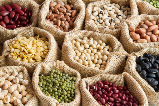 various of legumes in sack bag. organic food and creation of natural product concept.