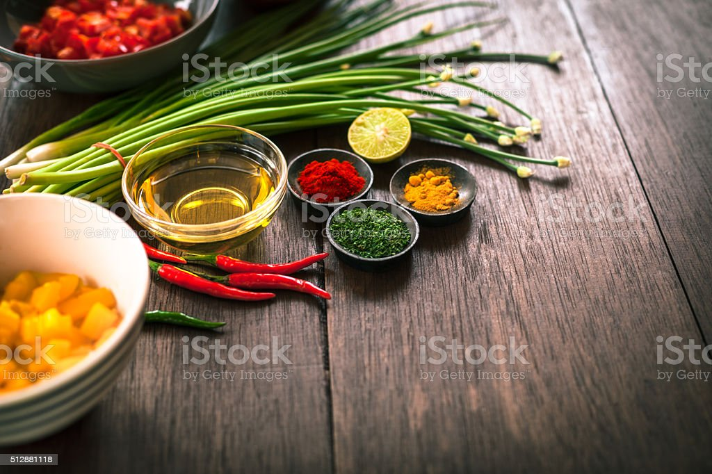 Various of spices and vegetable on dark rustic wooden background stock photo