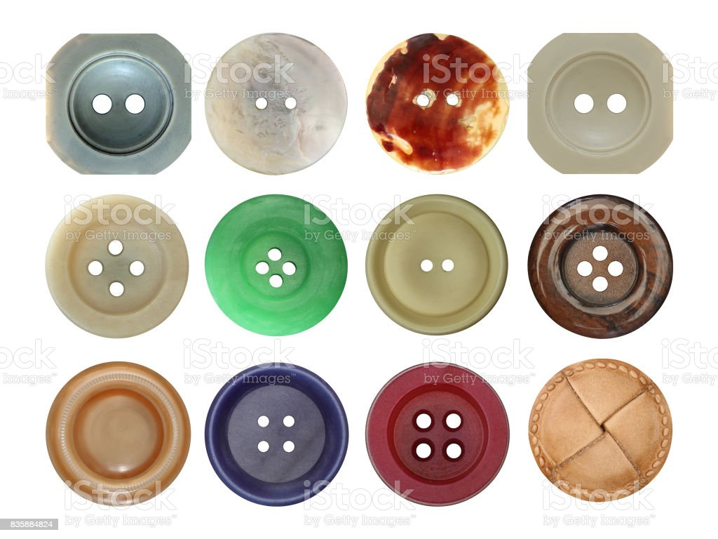 Various old and used buttons on white background stock photo