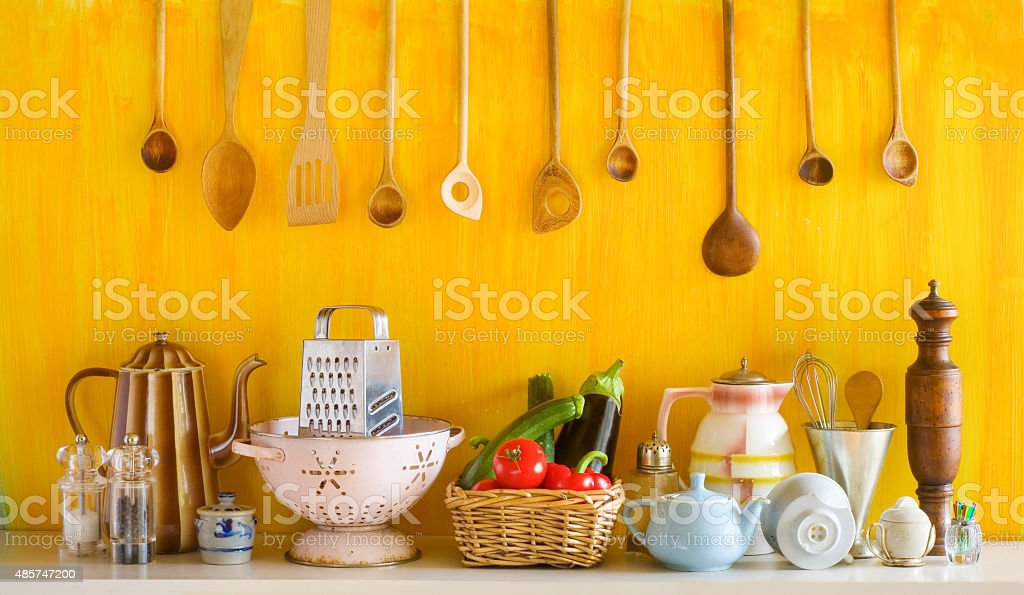 various old kitchen utensils and vegetables stock photo