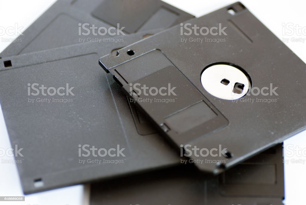 various old obsolete 3 inch floppy disk on white stock photo