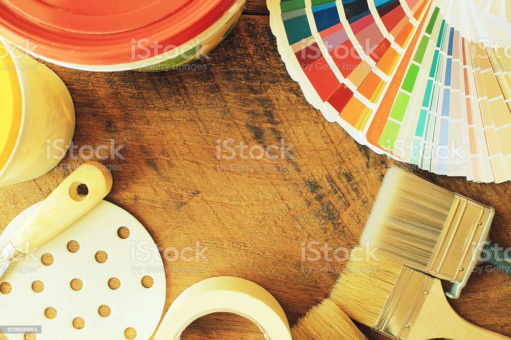 various painting tools and color guide on wooden background stock photo