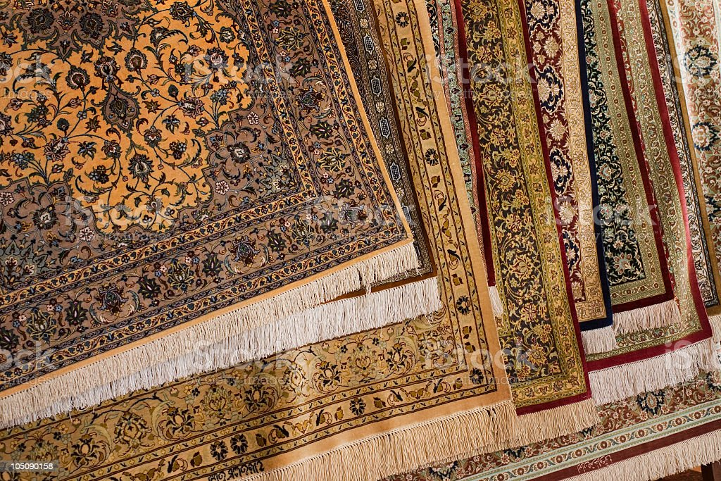 Various Persian carpet rugs in different colors stock photo