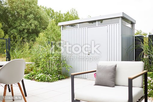 Various photos of a modern city garden with detailed pictures of flowers and garden furniture photographed in the spring with blurred background