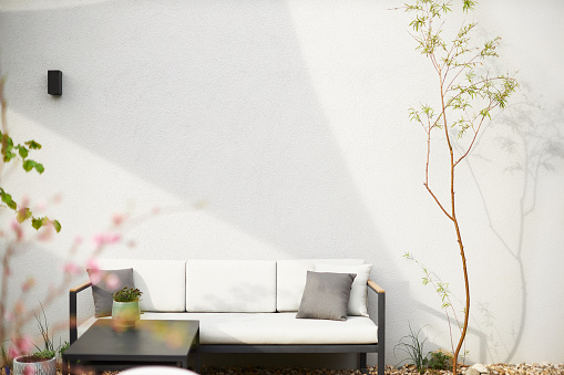 Various photos of a modern city garden with detailed pictures of flowers and garden furniture