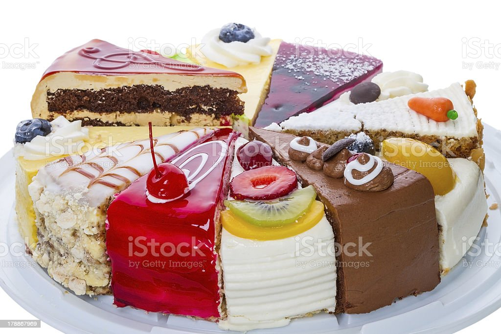 Various pieces of original cake on white royalty-free stock photo