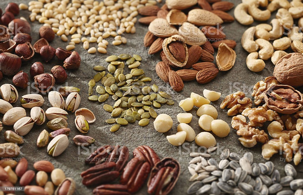 Various piles of nuts and seeds stock photo