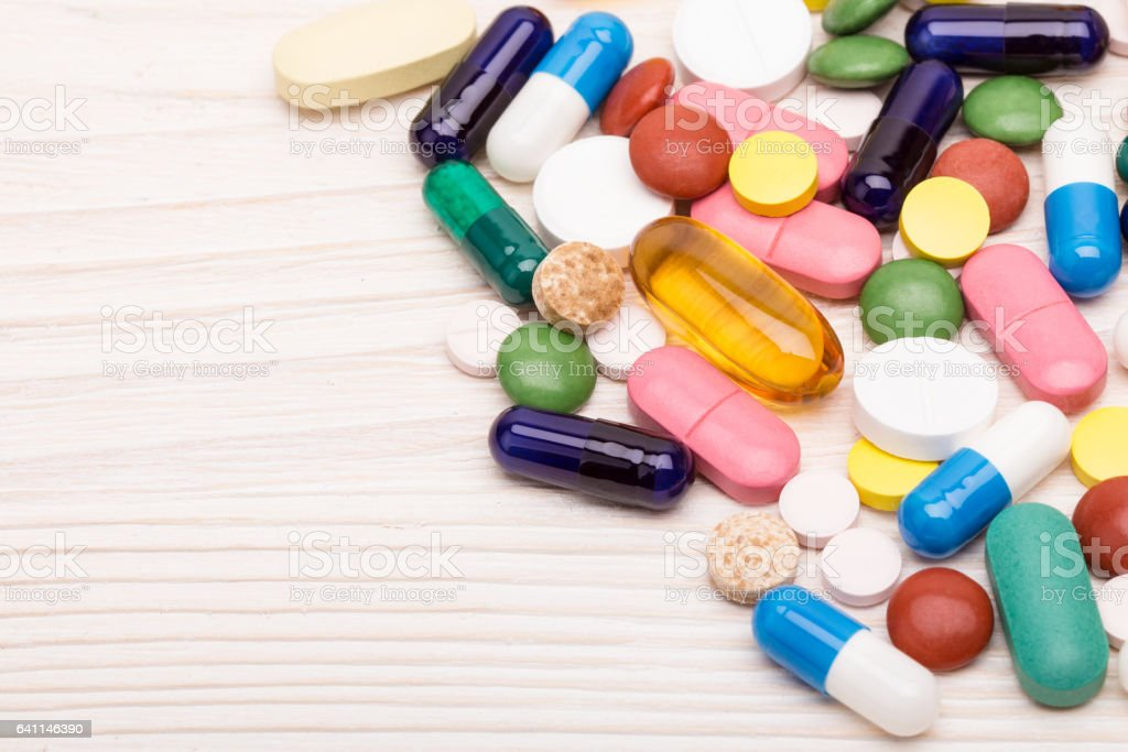 Various pills and capsules macro shot stock photo