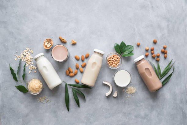 Various Plant Based Milk Various vegan plant based milk and ingredients, top view, copy space. Dairy free milk substitute drink, healthy eating. nut food stock pictures, royalty-free photos & images