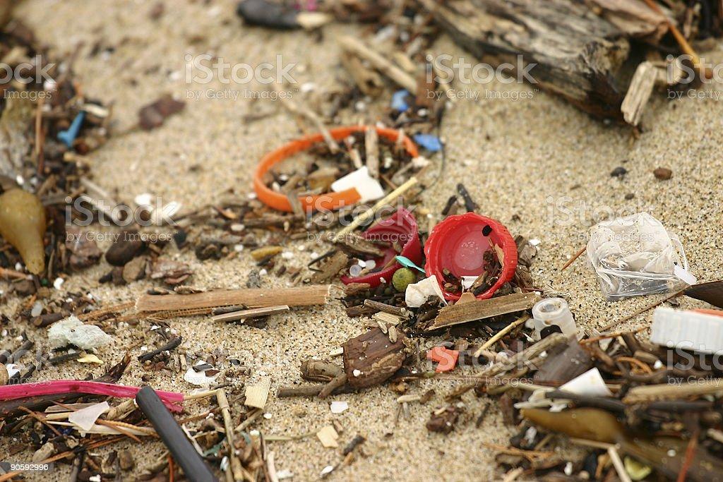 Various plastic debris on a beach stock photo