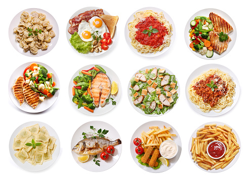 set of various plates of food isolated on white background, top view