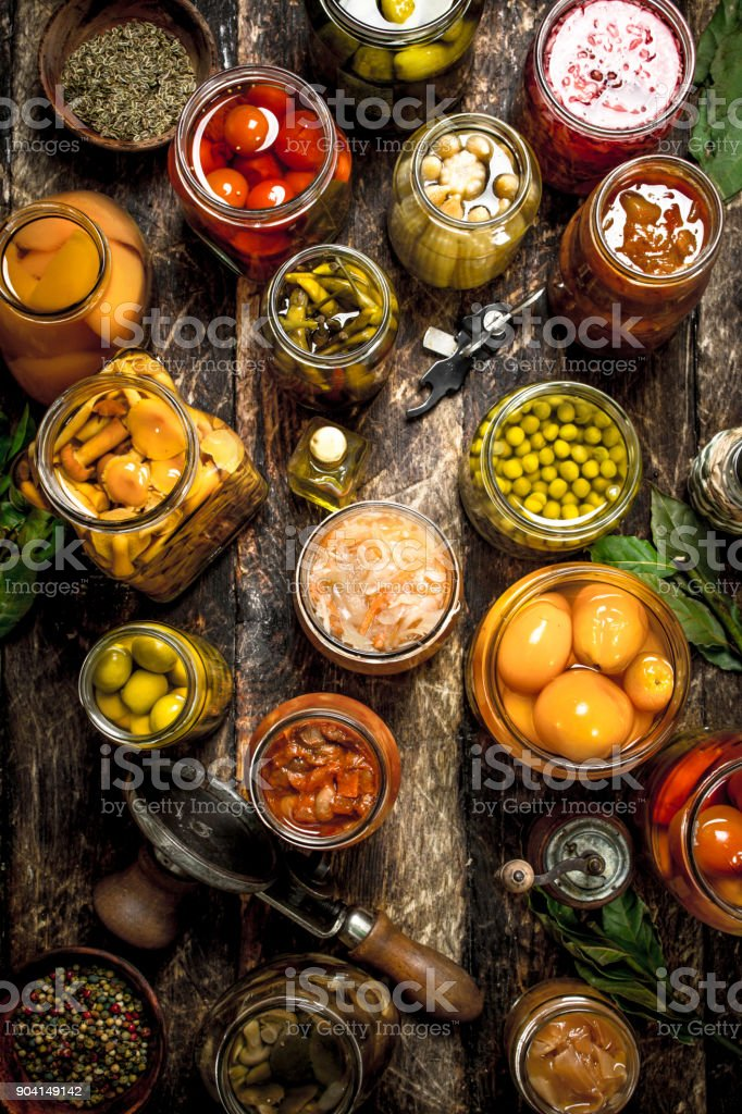 Various preserved vegetables and mushrooms with seamer and spices. stock photo