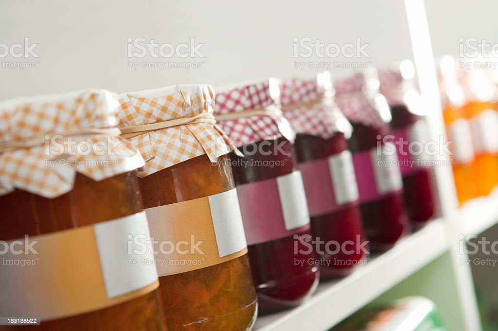 Various preserves in jars with labels stock photo
