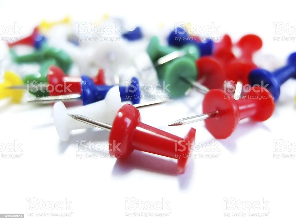 Various Pushpins on White background royalty-free stock photo