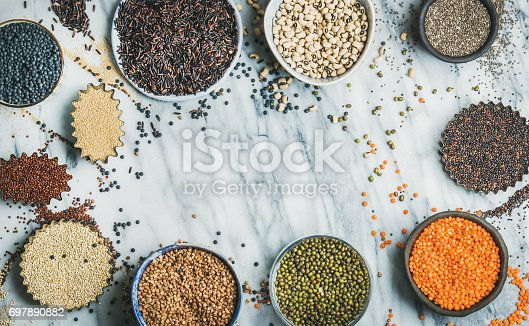 istock Various raw uncooked grains, beans, cereals in bowls and cups 697890882