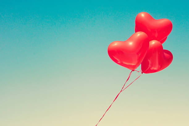 Various red heart shaped balloons stock photo