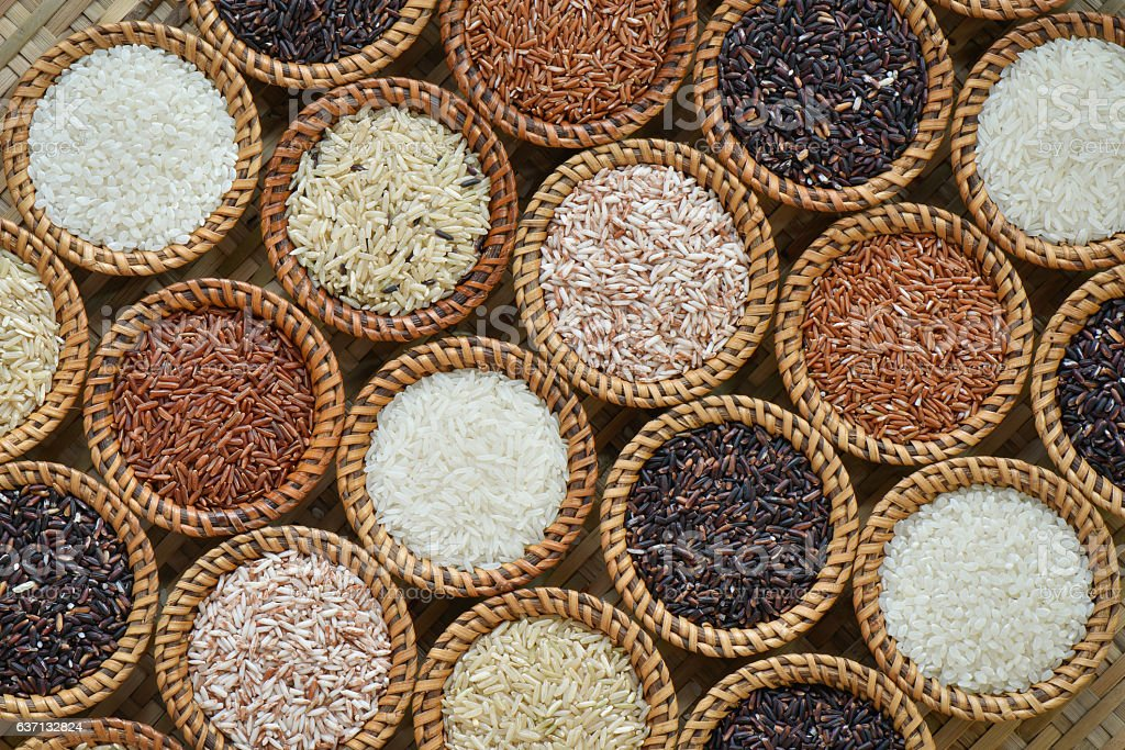 Various rice collection in wicker container for background stock photo