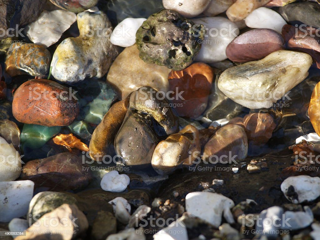 Various rocks in burn water stock photo