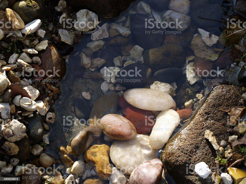 Various rocks in stream stock photo