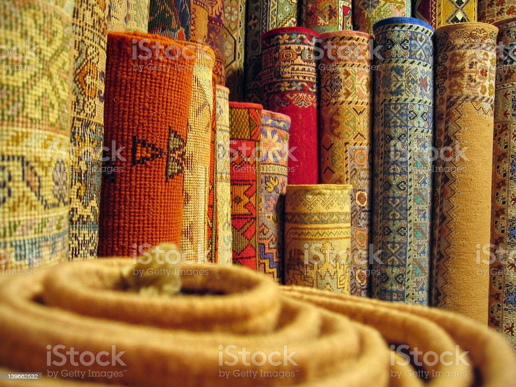 Various rolled up Moroccan rugs stock photo