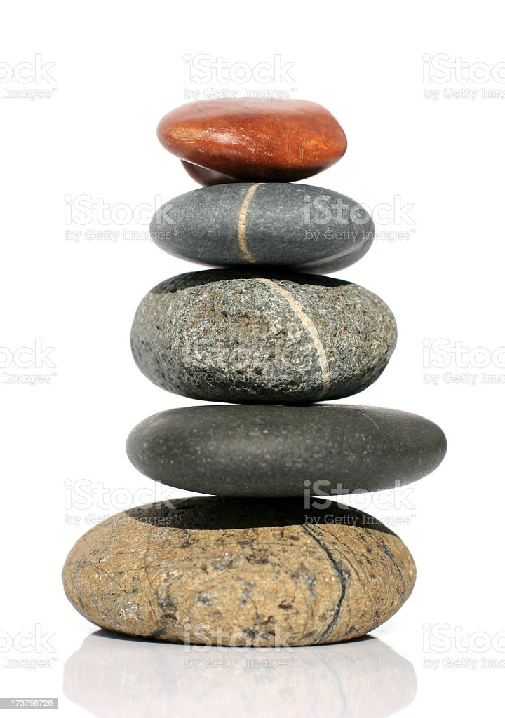 Various rounded stones balanced on top of each other royalty-free stock photo