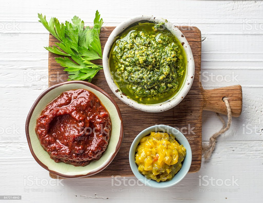 various sauces on wooden cutting board stock photo