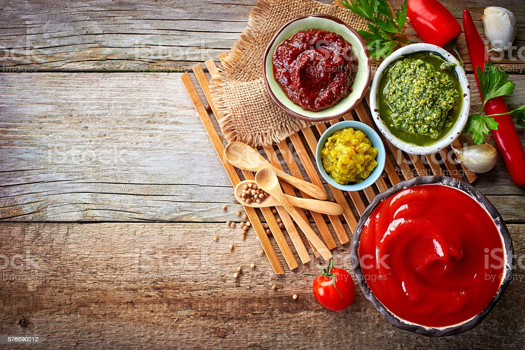 various sauces on wooden table stock photo
