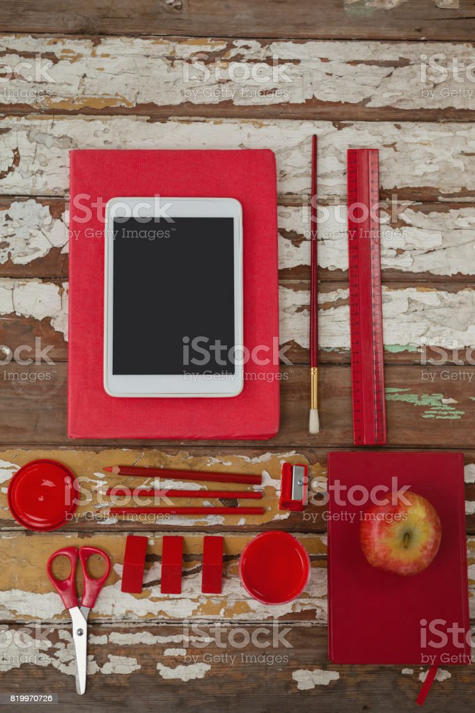 Various school supplies, apple and digital tablet on wooden table stock photo