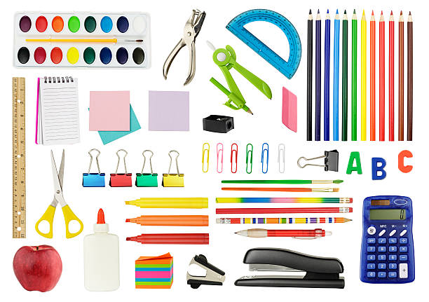 Various school supplies on white background stock photo