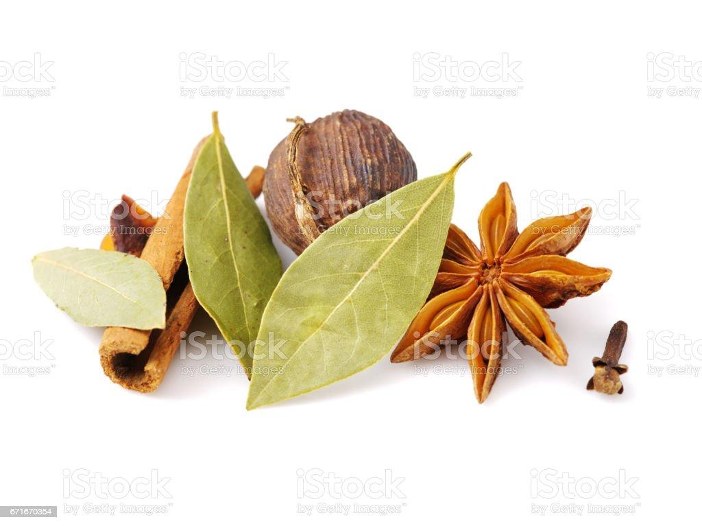 Various seasonings on white background stock photo