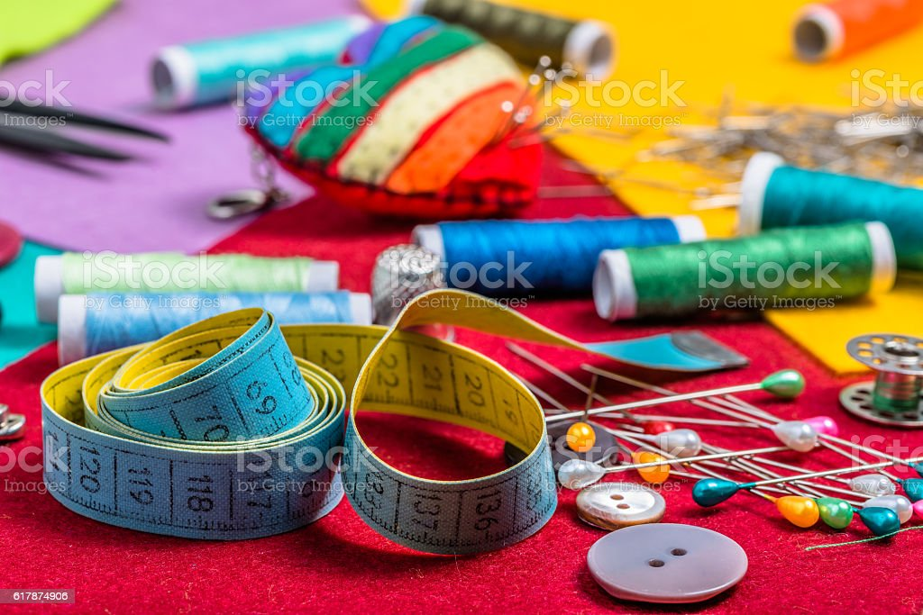 Various sewing accessories on a colored felt. stock photo