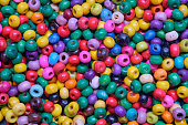istock Various sewing Colorful wooden beads as background. 1265144876