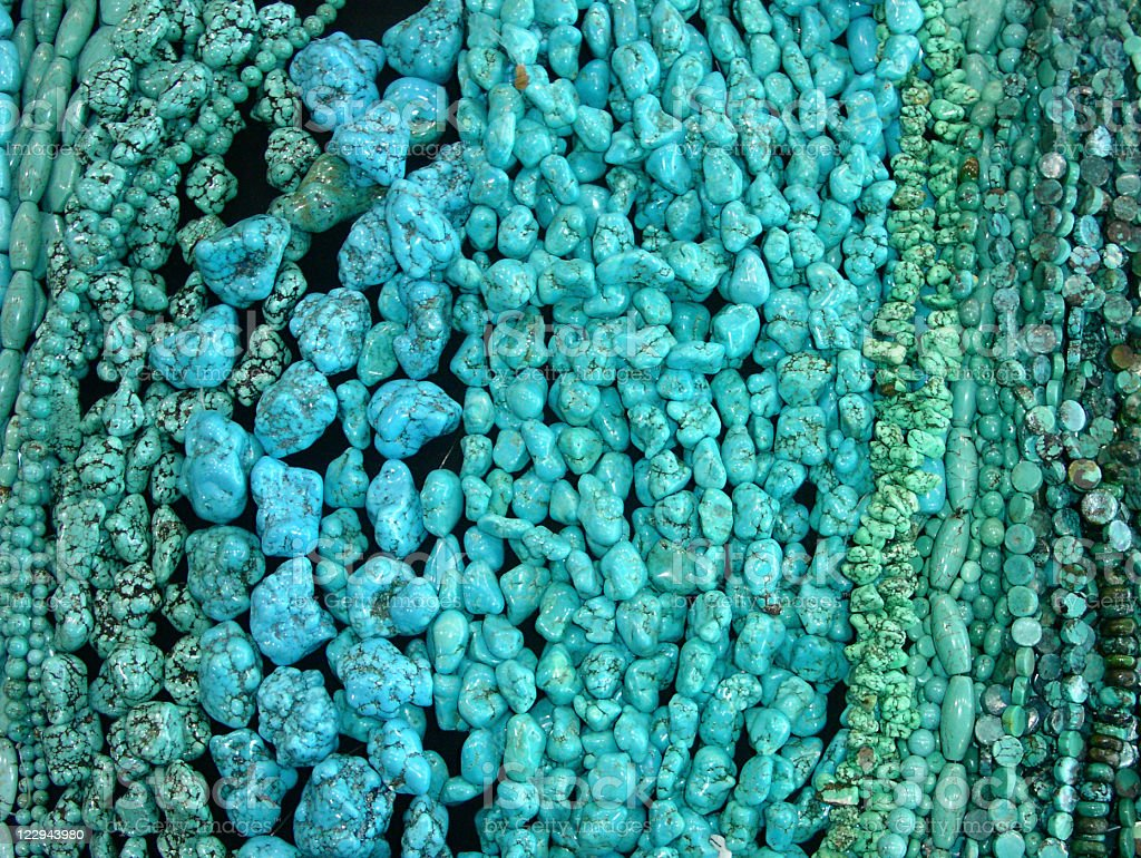 Various shapes of a turquoise beads royalty-free stock photo